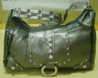 Ladies rexine hand bag in grey color